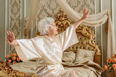 Serene old lady waking up in morning stock image