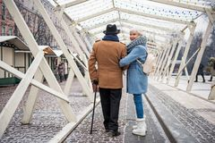 Serene old married couple walking along the street Stock Photos