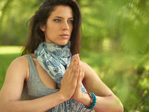Serene and peaceful woman practicing mindful awareness mindfulness by meditating in nature at sunset. Portrait of beautiful mixed race caucasian, african, middle Royalty Free Stock Image