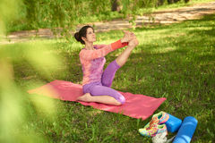 Serene and peaceful woman practicing mindful awareness mindfulness by meditating in nature at sunset. Portrait of beautiful mixed race caucasian, african, middle Royalty Free Stock Photography