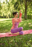 Serene and peaceful woman practicing mindful awareness mindfulness by meditating in nature at sunset. Portrait of beautiful mixed race caucasian, african, middle Stock Photo