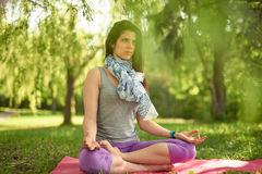 Serene and peaceful woman practicing mindful awareness mindfulness by meditating in nature at sunset. Portrait of beautiful mixed race caucasian, african, middle Royalty Free Stock Photos