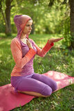 Serene and peaceful woman practicing mindful awareness mindfulness by meditating in nature at sunset Stock Photography