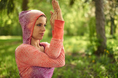 Serene and peaceful woman practicing mindful awareness mindfulness by meditating in nature at sunset. Portrait of beautiful mixed race caucasian, african, middle Royalty Free Stock Images