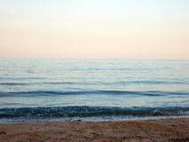Serene. Pink sunset and calm sea Royalty Free Stock Photo