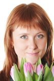 Serene redhead with pink tulips Stock Image
