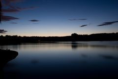 Serene and Reflective Lake. At dusk (Linlithgow Loch, Scotland Royalty Free Stock Photos