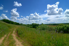 Serene rural landscape. Road river and clear sky Stock Photo