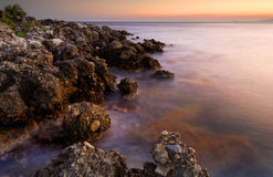 Serene seascape. Image shows a serene rocky seascape right after sunset Stock Photography