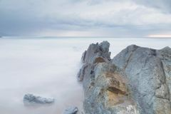 Serene seascape in Arrietara beach, Basque Country, Spain. Royalty Free Stock Photography