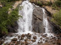 Serene Sound of the Waterfall Helen Hunt Falls. A waterfall is a place where water flows over a vertical drop or a series of steep drops in the course of a Royalty Free Stock Photos