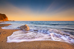 Serene South Dorset Beach e mare al tramonto Fotografie Stock Libere da Diritti
