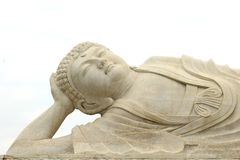 Peaceful white marble zen Buddha statue, China. White marble Reclining Buddha, isolated on a white background. This Buddha statue is in the Seven Star Crags royalty free stock image