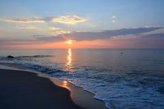 Serene Summer Sunrise Over Ocean. The sunrises over the ocean on a summer morning Royalty Free Stock Photography