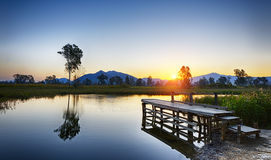 Serene Sunrise over fishing Jetty Royalty Free Stock Photo