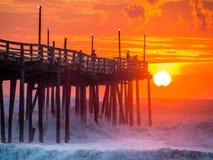 Sunrise over fishing pier at North Carolina Outer Banks. Serene sunrise over fishing pier at North Carolina Outer Banks royalty free stock photos