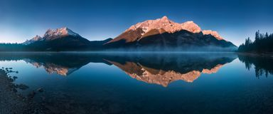 Serene sunrise at the Spray Lakes Reservoir is a reservoir in Alberta, Canada. The Spray Lakes royalty free stock photography