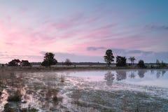 Serene sunrise on wild lake Stock Photo