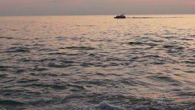 Motorboat Black Sea at sunset stock footage