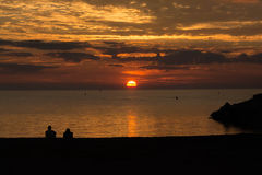 Serene Sunset on Lake Huron. Two people enjoying the end of the day on Lake Huron. The sunsets are absolutely incredible Royalty Free Stock Image