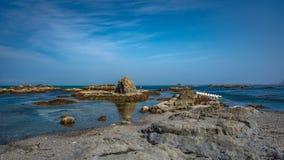 Serene Sunset Sea Stone Scenery foto de stock