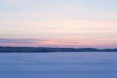 Serene sunset sky at winter. Finland Stock Photos