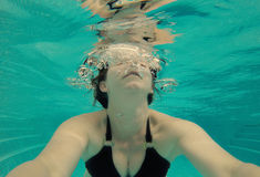 Serene under water selfie of woman in a pool Royalty Free Stock Photo