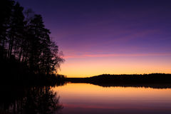 Serene view of calm lake at twilight Royalty Free Stock Photography