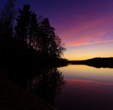 Serene view of calm lake at twilight Royalty Free Stock Photo