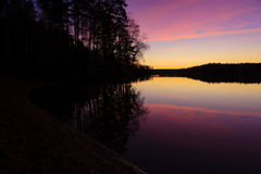 Serene view of calm lake at twilight Stock Photos