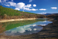 Lake with reflected clouds Royalty Free Stock Photography