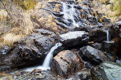 Serene waterfall from the melting snow on mountain during spring in Nepal Royalty Free Stock Photography