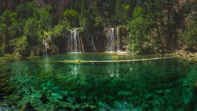 Serene Hanging Lake Waterfalls. Serene Waterfalls and clear green water at Hanging Lake, Glenwood Canyon, Colorado Stock Image