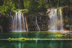 Serene Hanging Lake Waterfalls. Serene Waterfalls and clear green water at Hanging Lake, Glenwood Canyon, Colorado Stock Photo