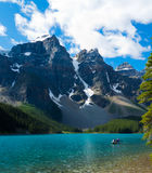 Serene waters of Moraine Lake. Morning on Moraine Lake, Banff (Alberta, Canada), in Rocky Mountains Royalty Free Stock Image
