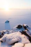 Serene winter morning view to frozen lake 库存图片