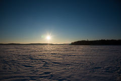 Serene winter morning view to frozen lake.  Royalty Free Stock Images