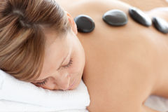 Serene woman having a stone therapy Royalty Free Stock Image