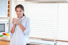 Serene woman holding a cup of tea Royalty Free Stock Photography