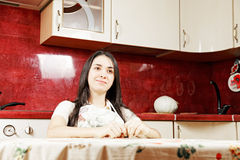 Serene woman in kitchen Royalty Free Stock Photos