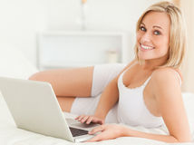 Serene woman with a laptop Stock Photos