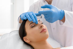 Serene Woman Receiving Injection In Face Royalty Free Stock Photo