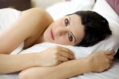 Serene woman relaxing in bed Royalty Free Stock Photo