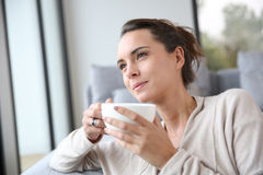Serene woman relaxing at home Stock Photo