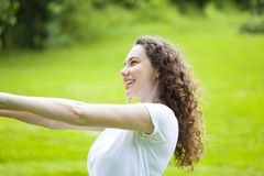 Serene Woman Relaxing At The Park stock image