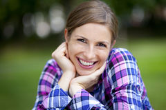 Serene Woman Smiling At The-Park Stockfotos