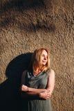 Serene Woman Standing nahe Wand Lizenzfreie Stockfotografie