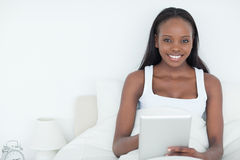Serene woman using a tablet computer Stock Photography