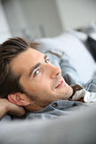 Serene young man daydreaming in sofa Royalty Free Stock Photo
