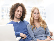 Serene young smiling couple with laptop Royalty Free Stock Images